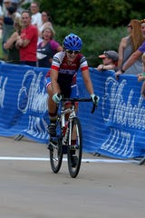 Richardson Bike Mart's Sheree Tomba crosses the finish line for the win during the 2019 Hotter'N Hell Hundred Women's criterium Friday evening around the MPEC.