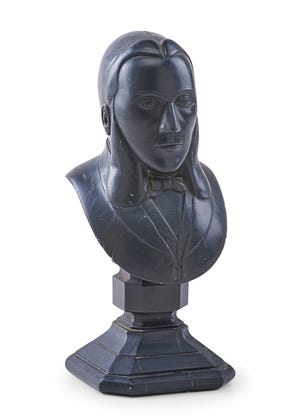 This 9 1/2-inch-tall carved bust made of black argillite sold for more than twice its estimate at $18,750. It depicts a European trader.