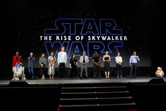 "Billy Dee Williams (from left), Anthony Daniels, Keri Russell, Naomi Ackie, Joonas Suotamo, Kelly Marie Tran, Oscar Isaac, John Boyega, Daisy Ridley, Lucasfilm president Kathleen Kennedy and director/producer/writer J.J. Abrams of ""Star Wars: The Rise of Skywalker"" at D23."