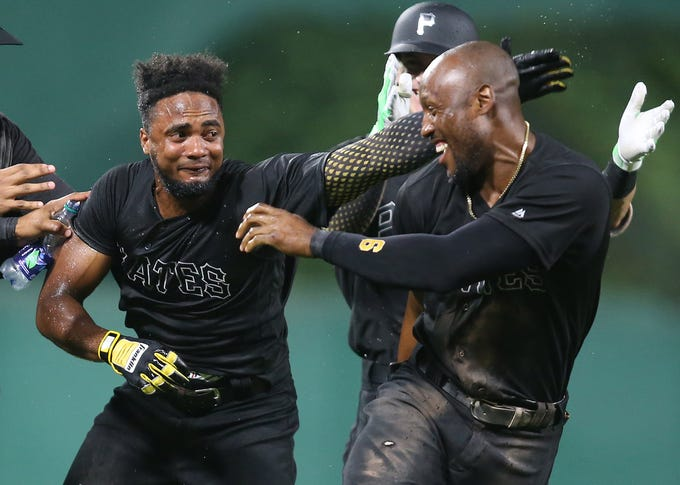 Aug. 23: Pittsburgh Pirates pinch hitter Pablo Reyes (left) reacts with teammate Starling Marte (right) after Reyes hit a game-winning single against the Cincinnati Reds during the ninth inning  at PNC Park. Pittsburgh won, 3-2.