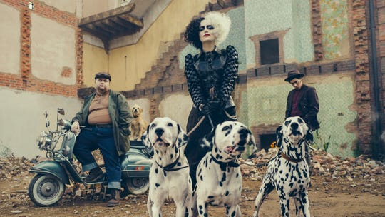 Emma Stone is all punked out with Dalmatians in first look at 'Cruella' from Disney's D23