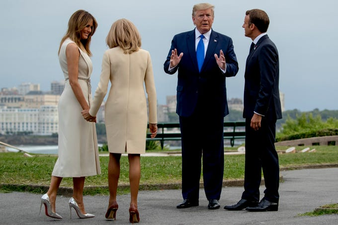 French President Emmanuel Macron, right, and Brigitte Macron welcome U.S. President Donald Trump and first lady Melania Trump, left, at the Biarritz lighthouse, southwestern France, ahead of a working dinner Saturday, Aug. 24, 2019. Shadowed by the threat of global recession, a U.S. trade war with China and the possibility of one against Europe, the posturing by leaders of the G-7 rich democracies began well before they stood together for a summit photo.
