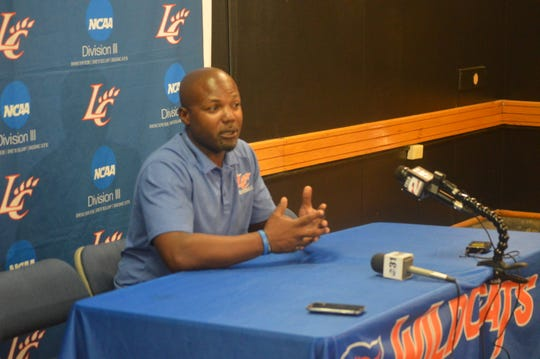 Louisiana College coach Justin Charles talks to media during the Wildcats' Media Day Saturday.