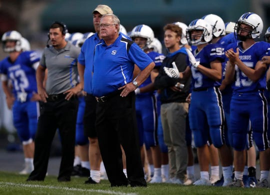 St. Mary's Springs head coach Bob Hyland leads his team against Lake Country Lutheran during their football game at Fruth Field on Aug. 24. Hyland has been voted the state coach of the year by the Associated Press.