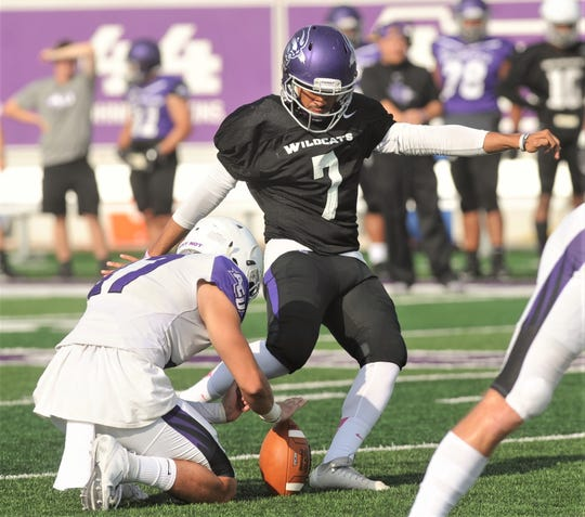 Abilene High grad Oscar Hernandez kicks a 23-yard field to give the White team a 3-0 lead over the Purple with 8:54 left in the first half. Hernandez also kicked three PATs in the White team's 24-7 win over the Purple in ACU's scrimmage Saturday, Aug. 24, 2019, at Wildcat Stadium.