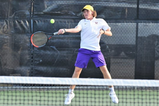 Wylie's Reid Heuerman jumps to hit a shot during the No. 4 boys singles match against Abilene High in the finals of the Abilene ISD Team Tennis Tournament. Heuerman won 6-4, 6-0 as the Bulldogs won 10-6. On the weekend, Heuerman was 8-0 including filling in at No. 1 singles for the semifinals to earn Local Player of the Week honors.