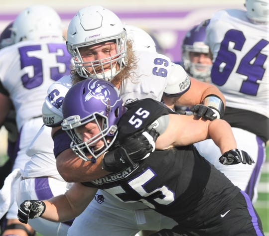 ACU offensive lineman Kade Parmelly, a Wylie grad, blocks a defender during the Wildcats' scrimmage at Wildcat Stadium. Parmelly, who started all 11 games last season, will play against Wylie grad Dion Novil when ACU plays North Texas on Saturday.