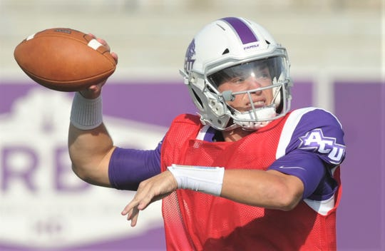 White team quarterback Luke Anthony looks to throw a pass in the first quarter of ACU's scrimmage Saturday, Aug. 24, 2019, at Wildcat Stadium.
