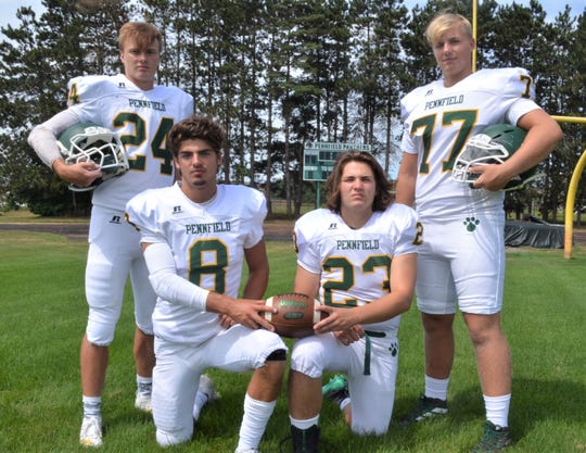 Pennfield captains, from left, Cody Hultink, Ryne Petersen, Seth Clothier, Jack Boyd.