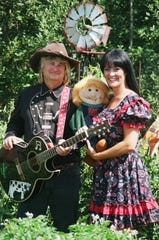 Cowboy Buck and Elizabeth play two shows daily on the Children's Stage.