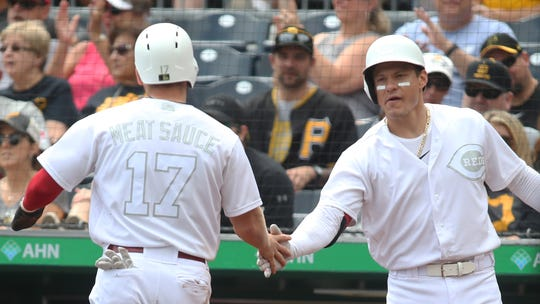 Aug 25, 2019; Pittsburgh, PA, USA;  Cincinnati Reds left fielder Josh VanMeter (17) is greeted by first baseman Derek Dietrich (22) after scoring a run against the Pittsburgh Pirates during the first inning of a MLB Players' Weekend game at PNC Park. Mandatory Credit: Charles LeClaire-USA TODAY Sports