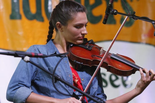 Ivy Phillips, 17, at the Old Time Fiddlers' Championship in Clarksville, Tenn., on Saturday, Aug. 24, 2019.