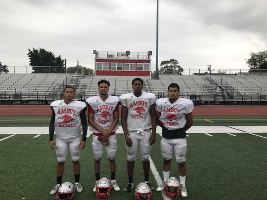 Perth Amboy football players (from left to right) Darvin Lantigua, Jeremy Fernandez, Kayzon Cherisme, Tony Saucedo