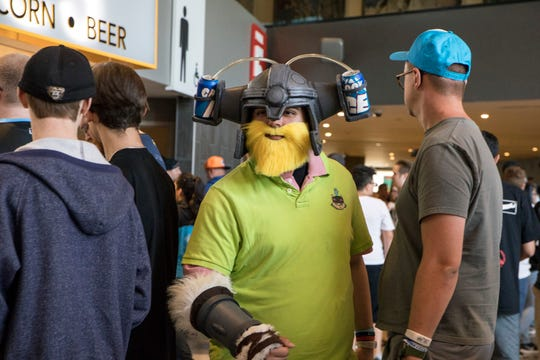 """Mike Cooley, makes his way through the beer line dressed as Olaf, of """"Brolaf"""" as fans call him with the beer helmet added at the 2019 LCS Summer Finals at Little Caesars Arena in Detroit, Mich., Sunday, Aug 25, 2019."""