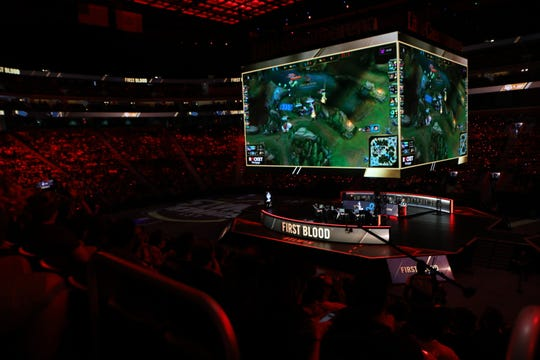 Little Caesars Arena lights up red as the first kill is made in the 2019 LCS Summer Finals in Detroit, Mich., Sunday, August 25, 2019.