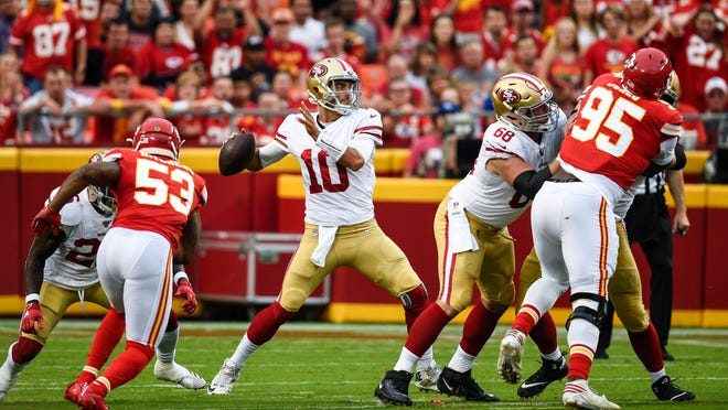 San Francisco 49ers quarterback Jimmy Garoppolo throws in the first quarter against the Kansas City Chiefs Saturday.