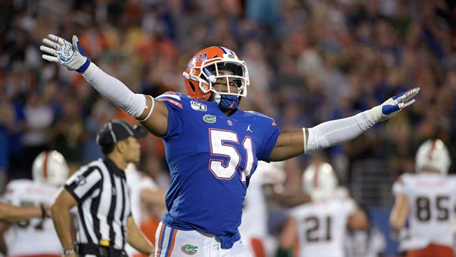 Florida linebacker Ventrell Miller (51) celebrates after a play during the second half Saturday. Florida beat Miami 24-20.