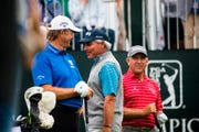 Retief Goosen, Fred Couples, and Scott Parel, from left, prepare to tee off during the first round of the PGA Tour Champions' Boeing Classic golf tournament Friday.