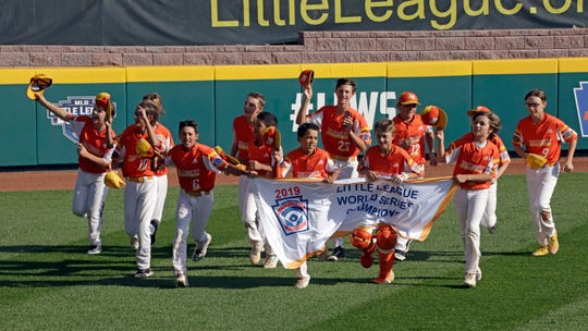 Louisiana takes a victory lap around the field at Lamade Stadium after winning the Little League World Series title.