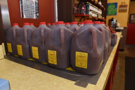 Gallons of cider sit on the front counter of Parmenter's.