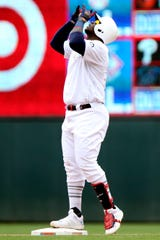 The Minnesota Twins' Miguel Sano points up to the sky after hitting a double against the Detroit Tigers during the fourth inning.