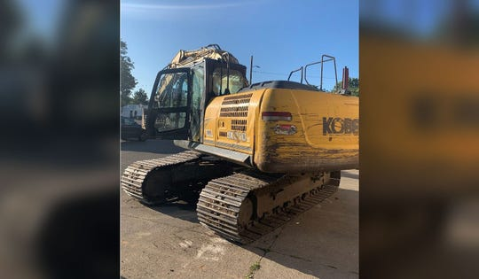 When employees of JR Liquor arrived to open the party store this morning, they saw a Kobelco SK210 Excavator parked in the parking lot and the front wall of the store smashed.