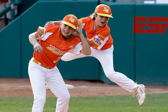 Louisiana's Derek DeLatte, right, celebrates with Egan Prather after getting the final out against Curacao in the Little League World Series championship game on Sunday.