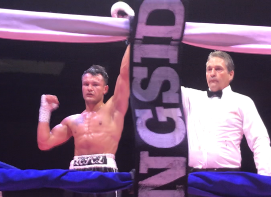 Referee Kevin McCarl raises the hand of Great Falls' Trinity Lopez in victory after Lopez beat Antonio Tessitore by unanimous decision Saturday night at Pacific Steel and Recycling Four Season Arena.