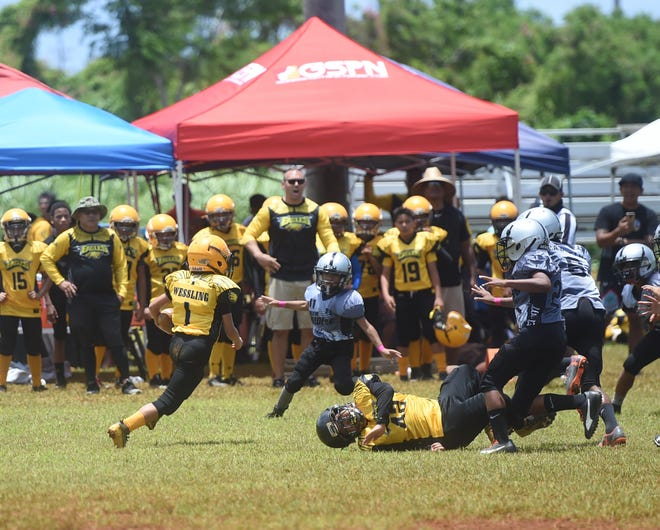In this file photo from Aug. 25, 2019, The Island Eagles' Isaac Wessling (1) attempts to bypass the Guam Raiders' defensive line during their GNYFF Metgot division game at the Mikkel Tan I. Vy Field in Tiyan.