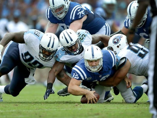 Colts quarterback Andrew Luck pounces on a fumble against the Tennessee Titans in 2015.