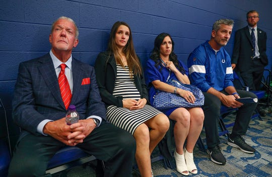 Indianapolis Colts owner Jim Irsay, Luck's wife Nicole Pechanec, Kalen Irsay Jackson and head coach Frank Reich listen and watch as Andrew Luck announces his retirement following their preseason game at Lucas Oil Stadium on Saturday, Aug 24, 2019.