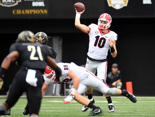 Oct 7, 2017; Nashville, TN, USA; Georgia Bulldogs quarterback Jacob Eason (10) attempts a pass during the second half against the Vanderbilt Commodores at Vanderbilt Stadium. Mandatory Credit: Christopher Hanewinckel-USA TODAY Sports