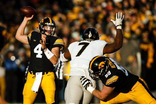 Nov 18, 2017; Iowa City, IA, USA; Iowa Hawkeyes quarterback Nathan Stanley (4) passes against Purdue Boilermakers defensive tackle Eddy Wilson (7) during the first half at Kinnick Stadium. Mandatory Credit: Brian Powers/The Des Moines Register via USA TODAY Sports