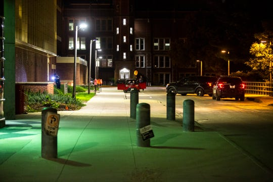 Iowa City and University of Iowa police respond to a call of a potential person with a gun, Saturday, Aug. 24, 2019, on the west side of the University of Iowa campus, near the Pharmacy Building.