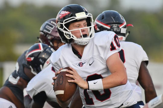South-Doyle quarterback Mason Brang drops back to pass in Saturday's game at Fulton High School in Knoxville, Tennessee. August 24, 2019.