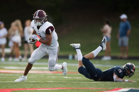 Bearden's Hayden Candela (1) runs the ball as West's Ethan Scott (15) falls to the ground during a TSSAA high school football game between West and Bearden at West Saturday, Aug. 24, 2019. West defeated Bearden in overtime 34-31.