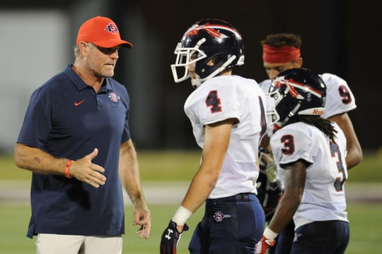South-Doyle head coach Clark Duncan speaks with players during the football game between South-Doyle and Fulton at Fulton High School in Knoxville, Tennessee on Saturday August 24, 2019.