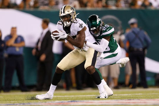 New York Jets' Alex Brown (25) tackles New Orleans Saints' Emmanuel Butler (17) during the first half of a preseason NFL football game Saturday, Aug. 24, 2019, in East Rutherford, N.J. (AP Photo/Adam Hunger)