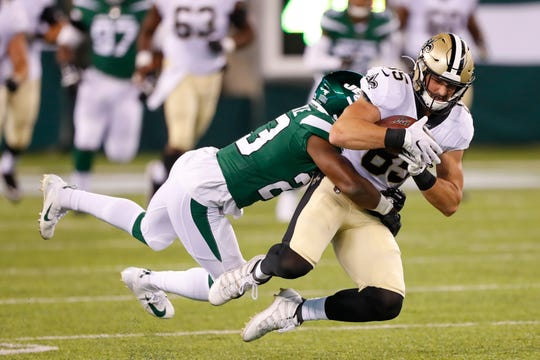 New York Jets' Godwin Igwebuike (23) tackles New Orleans Saints' Dan Arnold (85) during the second half of a preseason NFL football game Saturday, Aug. 24, 2019, in East Rutherford, N.J. (AP Photo/Noah K. Murray)