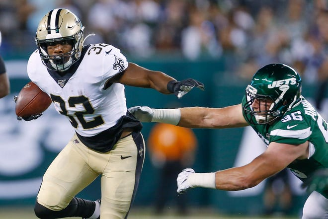 New Orleans Saints' Jacquizz Rodgers (32) stiff-arms New York Jets' Henry Anderson (96) during the first half of a preseason NFL football game Saturday, Aug. 24, 2019, in East Rutherford, N.J. (AP Photo/Adam Hunger)