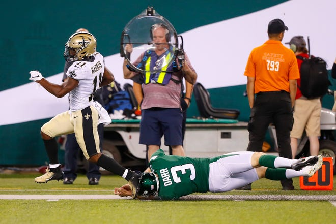 New Orleans Saints' Deonte Harris (11) breaks a tackle by New York Jets' Matt Darr (3) during the second half of a preseason NFL football game Saturday, Aug. 24, 2019, in East Rutherford, N.J. Harris scored a touchdown on the play. (AP Photo/Noah K. Murray)