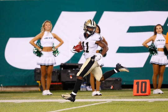 New Orleans Saints' Deonte Harris (11) returns a punt for a touchdown during the second half of a preseason NFL football game against the New York Jets Saturday, Aug. 24, 2019, in East Rutherford, N.J. (AP Photo/Noah K. Murray)