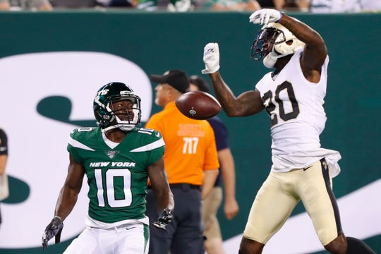 New Orleans Saints' Ken Crawley (20) breaks up a pass to New York Jets' Deonte Thompson (10) during the second half of a preseason NFL football game Saturday, Aug. 24, 2019, in East Rutherford, N.J. (AP Photo/Noah K. Murray)