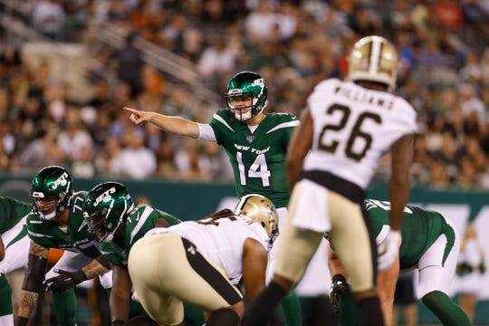 New York Jets quarterback Sam Darnold (14) points to the defense during the first half of a preseason NFL football game against the New Orleans Saints Saturday, Aug. 24, 2019, in East Rutherford, N.J. (AP Photo/Adam Hunger)