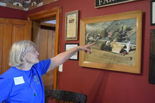 Jean Schmelzer, one of 12 kids in the third generation of this 4th-generation farm, points out some differences between the original layout and the current layout of the Joos Family Farm.The farm was awarded its Century Farm status Aug. 24.
