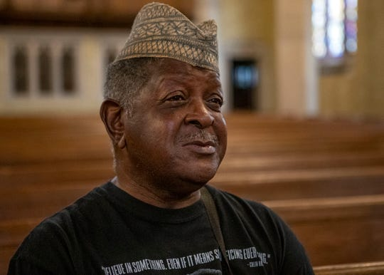 James Deke Pope sat in the stained-glass sanctuary during the bells of Idlewild Presbyterian Church toll  in commemoration of the first enslaved Africans who landed in English North America in 1619.