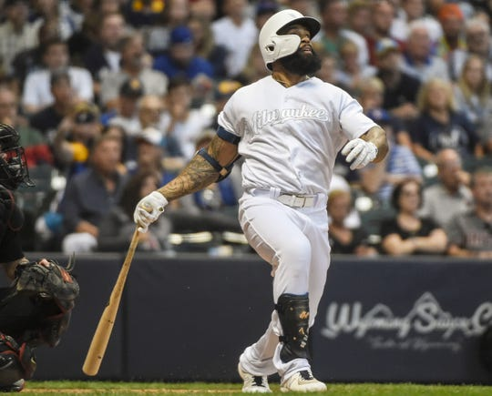 Brewers first baseman Eric Thames watches his solo home run in the fourth inning.