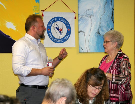Fayetteville resident Josh Mahony (left) visits with Baxter County Democratic Club Secretary Glenda Bodenhamer during a meeting of the group earlier this year. Mahony is challenging incumbent U.S. Senator Tom Cotton and was a guest of the Democratic Club's regular monthly meeting.