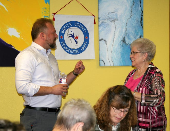 Fayetteville resident Josh Mahony (left) visits with Baxter County Democratic Club Secretary Glenda Bodenhamer Saturday morning at the Lake Country Cookhouse. Mahony is challenging incumbent U.S. Senator Tom Cotton and was a guest of the Democratic Club's regular monthly meeting.
