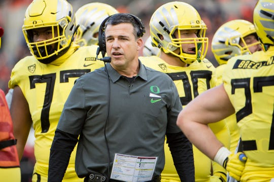 Oregon head coach Mario Cristobal talks to his players during a game against Oregon State Beavers at Reser Stadium. on Nov. 23, 2018 in Corvallis, OR.